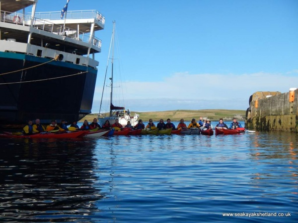 An impressive lineup of kayaks to support the Bressay to Lerwick swim